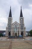 Catholic church with the Mary statue in Chantaburi, Thailand. Chantaburi, Thailand - April 18, 2015: Mary statue stands in front of Catholic church in Chantaburi Royalty Free Stock Images