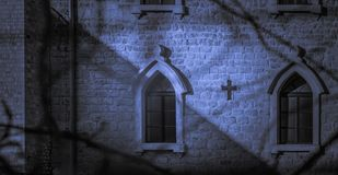 Catholic church at night, moonlight shadows royalty free stock photos