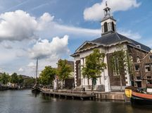 Catholic Church in old historic harbor of Schiedam, The Netherlands. Nice Weather and Catholic Church in old historic harbor of Schiedam, The Netherlands royalty free stock image