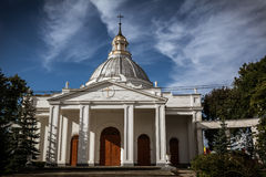 Catholic church in the park. Saints Peter and Paul Cathedral, catholic church in Daugavpils, Latvia. Blue sunny sky with nice artistic clouds in the background Royalty Free Stock Images