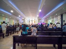 Dubai, UAE - May 15, 2018:: Catholic church during the service with people.. Christianity in Muslim countries. Catholic church during the service with people stock images