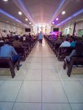 Dubai, UAE - May 15, 2018:: Catholic church during the service with people.. Christianity in Muslim countries. Catholic church during the service with people royalty free stock photography