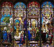 Catholic church stained windows mosaic. Panorama in different colors on different religion subject - matter Stock Images
