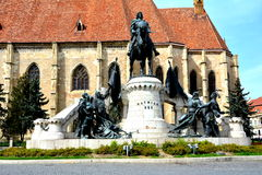 Catholic church and statue of Matei Corvin in Cluj-Napoca, Transylvania Stock Image