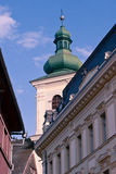 Catholic Church Tower. Image showing the Catholic Church Tower in Sibiu and the sorrouding buildings, the Town Hall and an interbelic appartment building Royalty Free Stock Photography