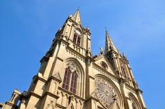 Catholic church tower under blue sky Stock Images