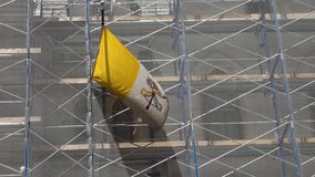The Catholic Church Under Construction. Pope Francis has vowed to reform the Catholic Church. This video, of the Vatican flag on scaffolding, is an apt metaphor stock footage
