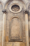 Catholic church wall with columns and round window.  Royalty Free Stock Images