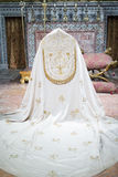 Catholic clerical cloak. Detailed view of white catholic robe, holy cloak in a church royalty free stock image