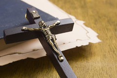Catholic cross with a crucifix on manuscripts Royalty Free Stock Photo