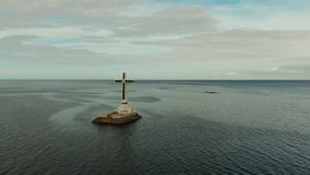 Catholic cross in a flooded cemetery in the sea near the island of Camiguin. stock footage