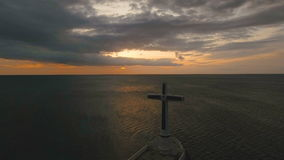 Catholic cross in the sea. stock footage