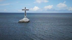 Catholic cross in the sea. stock video