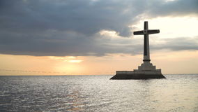 Catholic cross in the sea. Sunken Cemetery cross in Camiguin Island, Philippines. Large crucafix marking the underwater sunken cemetary of the coast of camiguin stock footage