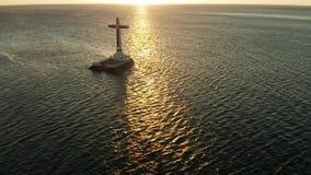 Sunken Cemetery cross in Camiguin island, Philippines. Catholic cross in sunken cemetery in the sea at sunset, aerial view. Sunset at Sunken Cemetery Camiguin stock video