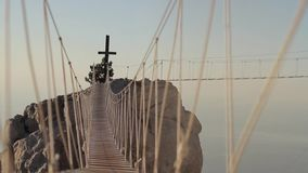 Catholic Cross at Sunset. View of the catholic cross and rope ladder over the abyss. Crimea, Ukraine.Ayu Dag Mountain view from the top of Ai Petri mountain stock video