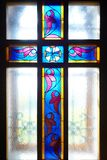 Catholic cross on the window (stained glass) Stock Photo
