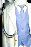 Catholic first communion uniform. Catholic first communion religious ceremony uniform white suit blue shirt and tie for boys on sale in store Royalty Free Stock Photography