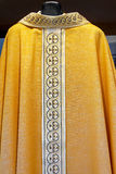Catholic Golden Dress Stock Image