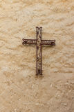 Catholic iron cross in wall Stock Photography