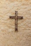 Catholic iron cross in wall Stock Photography