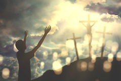 Catholic man prays with open arms Stock Photos