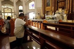 Free Catholic Men And Women Kneel Down And Pray Inside The Antipolo Cathedral Or The Our Lady Of Peace And Good Voyage Church Royalty Free Stock Photos - 170975148