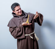 Catholic monk with Eiffel tower gift Royalty Free Stock Images