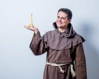Catholic monk with Eiffel tower gift Stock Photos