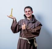 Catholic monk with Eiffel tower gift Royalty Free Stock Photos