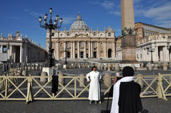 Catholic nun posing in the front of the Saint Peter Basilica in Royalty Free Stock Photography