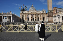 Catholic nun posing in the front of the Saint Peter Basilica in Stock Photo