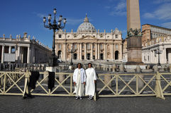 Catholic nun posing in the front of the Saint Peter Basilica in Stock Photography