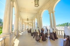 Catholic Nuns at Fatima. Fatima, Portugal - August 15, 2017: group of nuns walks under arcade at Sanctuary of Our Lady of Fatima, one of the most important royalty free stock photography