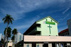 Catholic pastoral center information service and church in Penang Malaysia. Penang, Malaysia - January 15, 2016: A green building with a large cross which is the Royalty Free Stock Image