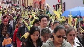 Catholic people procession celebrating the Palm Sunday. GUANAJUATO, MEX 2016 (ILLUSTRATIVE IMAGE). Catholic people procession celebrating the Palm Sunday. They stock video footage