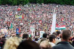 Catholic pilgrims gathering to celebrate the Pentecost. Pilgrims from all over the world gather to celebrate the Pentecost catholic tradition on May 2012 in stock images