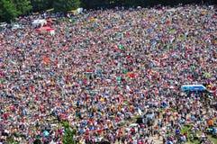 Catholic pilgrims gathering to celebrate the Pentecost. SUMULEU CIUC, ROMANIA - JUNE 6, 2014: Hungarian Catholic pilgrims, crowd of people gathering in royalty free stock image