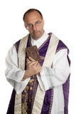 Catholic Priest with Bible in church Royalty Free Stock Images