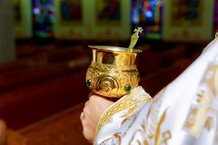 Catholic priest with chalice cup during consecration ceremony. Church, mass, catholic Stock Photos