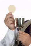 Catholic priest with chalice and host at Communion. A Catholic priest with chalice and host at Communion Stock Image