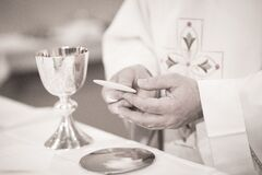 Catholic priest in church wedding marriage ceremony Stock Images