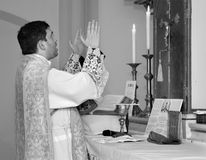 Catholic priest at tridentine mass Stock Photos
