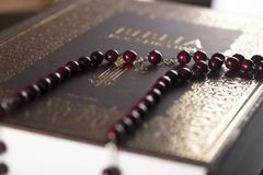Catholic religion theme - holy communion concept. Holy Bible and rosary on wooden background. Place for text royalty free stock images