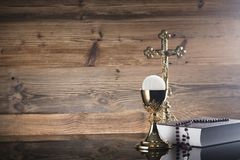 Catholic religion theme - Holy communion concept. Symbols of Christianity religion, brown wooden background. Place for text Stock Photo