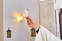 Catholic religious ceremony of Eucharist. Selective focus stock images