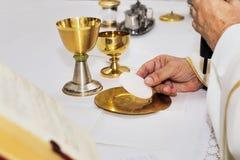 Catholic religious ceremony of Eucharist. Selective focus stock photos