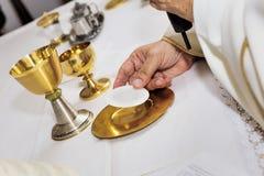 Catholic religious ceremony of Eucharist. Selective focus stock image
