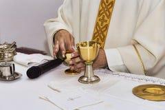 Catholic religious ceremony of Eucharist - selective focus. Catholic religious ceremony of Eucharist stock image