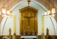Catholic religious cross and altar. Inside a church Royalty Free Stock Photography
